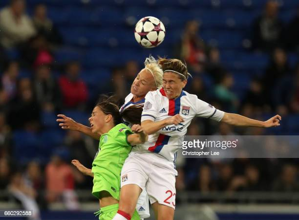 Camille Abily of Olympique Lyon and Caroline Seger of Olympique Lyon beat Sara Bjork Gunnarsdottir of VFL Wolfsberg in the air during the Women's...