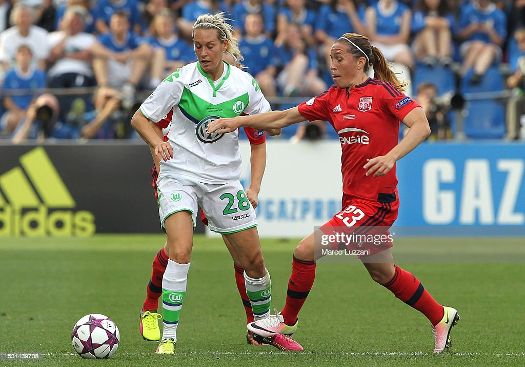 Camille Abily (R) of Olympique Lyonnais competes for the ball with Lena Goessling (L) of VfL Wolfsburg during the UEFA Women's Champions League Final VfL Wolfsburg and Olympique Lyonnais between at Mapei Stadium - Citta' del Tricolore on May 26, 2016 in Reggio nell'Emilia, Italy.