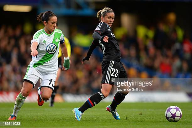 Camille Abily of Olympique Lyonnais is marshalled by Nadine Kessler of VfL Wolfsburg during the UEFA Women's Champions League Final Match between VfL...