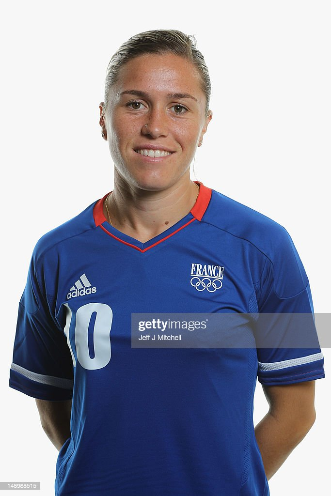 <a gi-track='captionPersonalityLinkClicked' href=/galleries/search?phrase=Camille+Abily&family=editorial&specificpeople=2151492 ng-click='$event.stopPropagation()'>Camille Abily</a> poses during the France Women's official Olympic Football Team portraits on July 21, 2012 in Glasgow, Scotland.