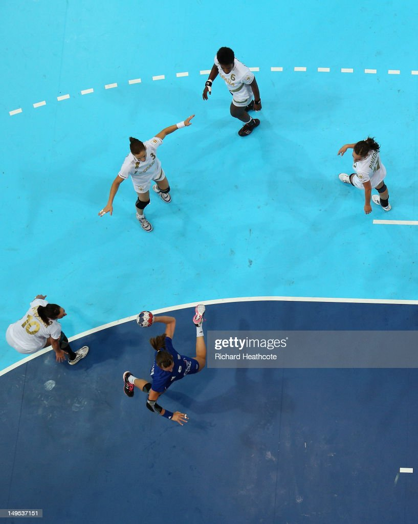 <a gi-track='captionPersonalityLinkClicked' href=/galleries/search?phrase=Camille+Ayglon&family=editorial&specificpeople=4571190 ng-click='$event.stopPropagation()'>Camille Ayglon</a> of France scores a goal during the Women's Handball Preliminaries Group B - Match 10 between France and Spain on Day 3 of the London 2012 Olympic Games at the Copper Box on July 30, 2012 in London, England.