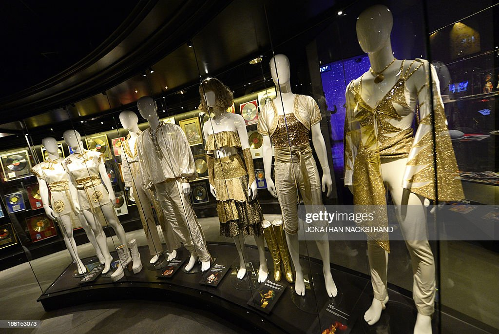 Camille BAS-WOHLERT This picture taken on May 6, 2013 in Stockholm shows the Gold Room, featuring golden records, costumes, at world's first permanent ABBA museum, on the eve of the official opening. Swedish group ABBA dominated the 1970s disco scene with their catchy melodies and kitsch dance routines.