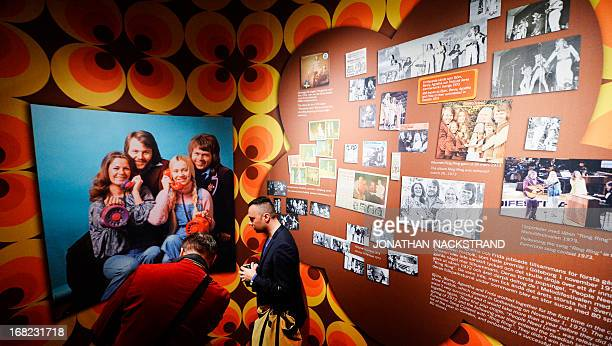 Camille BASWOHLERT Visitors look at photos featuring Swedish disco band ABBA members on May 7 2013 in Stockholm at world's first permanent ABBA...