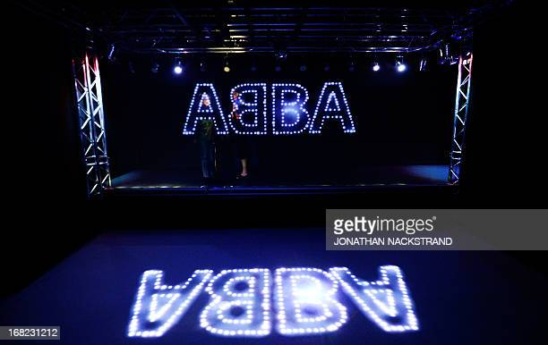 Camille BASWOHLERT Visitors pass by the name of Swedish disco band ABBA displayed on May 7 2013 in Stockholm in an installation exhibited at world's...