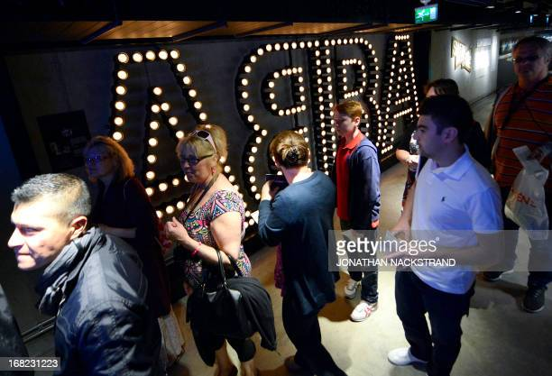 Camille BASWOHLERT Visitors pass by the name of Swedish disco band ABBA displayed on May 7 2013 in Stockholm as they queue to enter world's first...