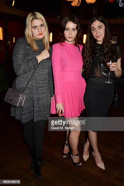 Camille Benett Billie Porter and guest attend the LOVE x Balmain Xmas Party at The Ivy Market Grill on December 15 2014 in London England