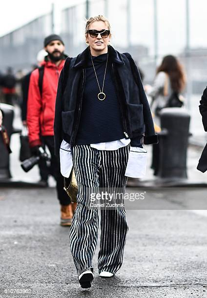 Camille Charriare is seen outside the Coach show wearing a blue coat and black and white striped pants during New York Fashion Week Women's...