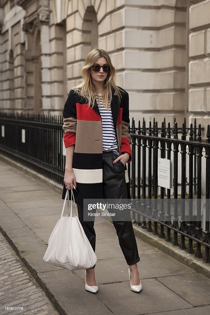 Camille Charriere fashion journalist and blogger wearing Jaeger jacket, Mango trousers and shoes, Jimmy Choo bag, on day 2 of London Womens Fashion Week Autumn/Winter 2013 on February 16, 2013 in London, England.