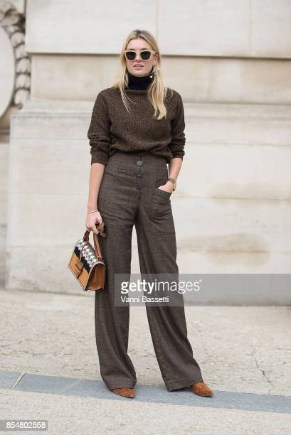 Camille Charriere poses with a Loewe bag after the Maison Margiela show at the Grand Palais during paris Fashion week Womenswear SS18 on September 27...
