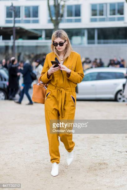 Camille Charriere wearing a mustard overall outside Loewe on March 3 2017 in Paris France