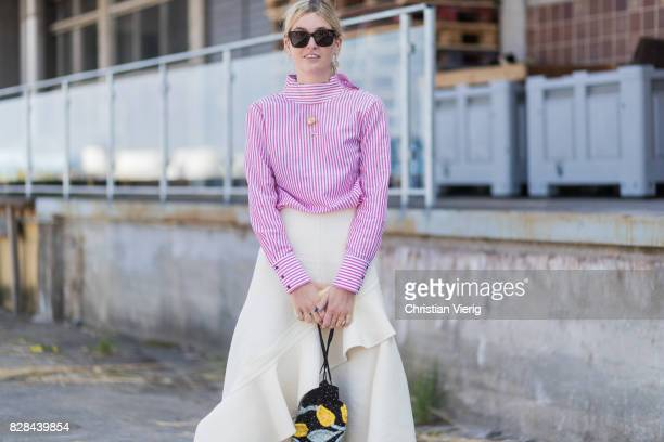 Camille Charriere wearing a red white striped button shirt with slit on the back creme skirt outside By Malene Birger on August 09 2017 in Copenhagen...