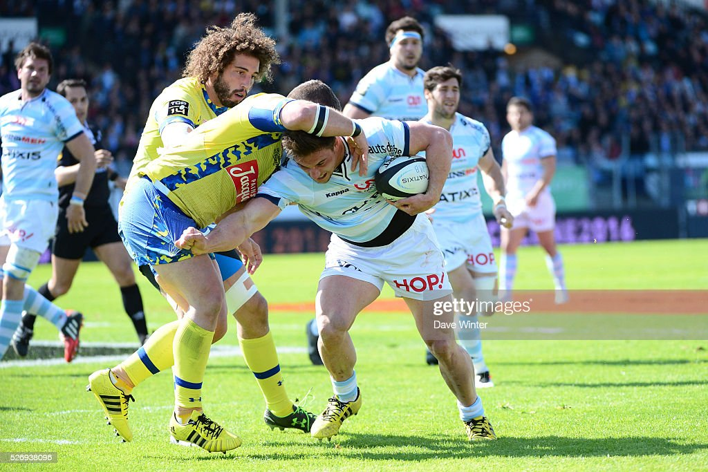 Camille Chat of Racing 92 takes on Benjamin Kayser of Clermont as Camille Gerondeau of Clermont looks on during the French Top 14 rugby union match between Racing 92 v Clermont at Stade Yves Du Manoir on May 1, 2016 in Colombes, France.