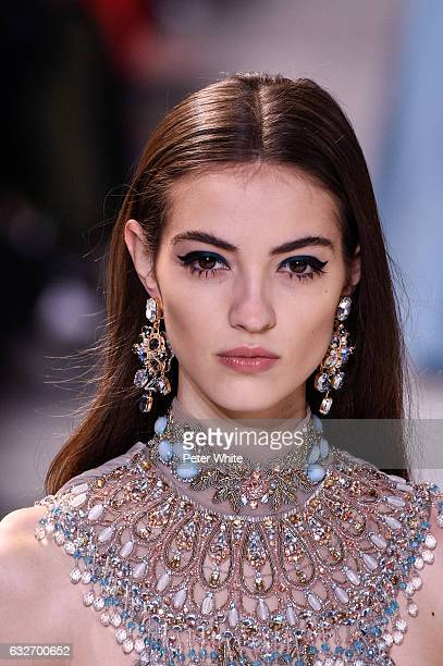 Camille Hurel walks the runway during the Elie Saab Spring Summer 2017 show as part of Paris Fashion Week on January 25 2017 in Paris France