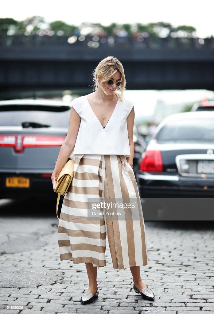 Camille is seen outside the Tibi show wearing Balenciaga top Tibi skirt Celine Bag and Jimmy Choo flats on September 6 2014 in New York City
