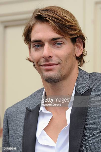 Camille Lacourt arrives for the Chanel Ready to Wear Spring/Summer 2011 show during Paris Fashion Week at Grand Palais on October 5 2010 in Paris...