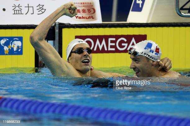 Camille Lacourt of France and team mate Jeremy Stravius celebrate their dead heat gold medal in the Men's 100m Backstroke Final during Day Eleven of...