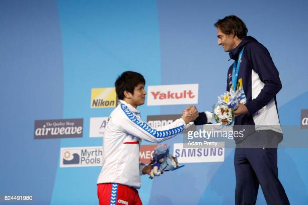 Camille Lacourt of France celebrates his gold medal with Silver Medalist Junya Koga of Japan in the Men's 50m Backstroke Final on day seventeen of...