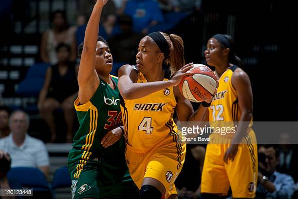 Camille Little of the Seattle Storm posts up against Amber Holt of the Tulsa Shock during the WNBA game on July 30 2011 at the BOK Center in Tulsa...
