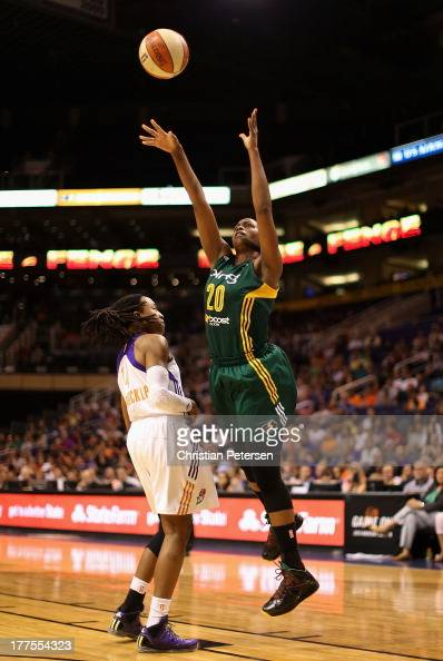 Camille Little of the Seattle Storm puts up a shot over Alexis Hornbuckle of the Phoenix Mercury during the WNBA game at US Airways Center on August...