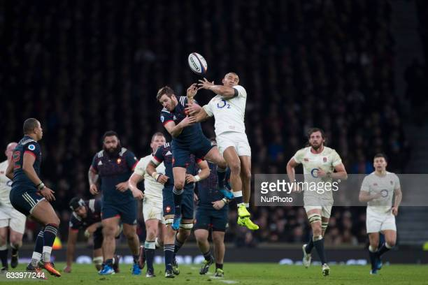 Camille Lopez of France and Jonatan Joseph of England tussle for a high kick during the RBS 6 Nations match between England and France at Twickenham...