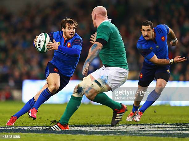 Camille Lopez of France runs at Paul O'Connell of Ireland during the RBS Six Nations match between Ireland and France at Aviva Stadium on February 14...