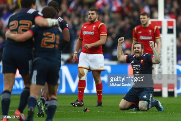 Camille Lopez of France sinks to his knees after converting a try to claim a 2018 victory during the RBS Six Nations match between France and Wales...