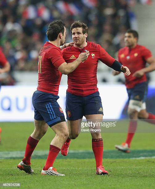 Camille Lopez the France standoff who kicks five penalties in the match is congratulated by team mate Morgan Parra during the RBS Six Nations match...