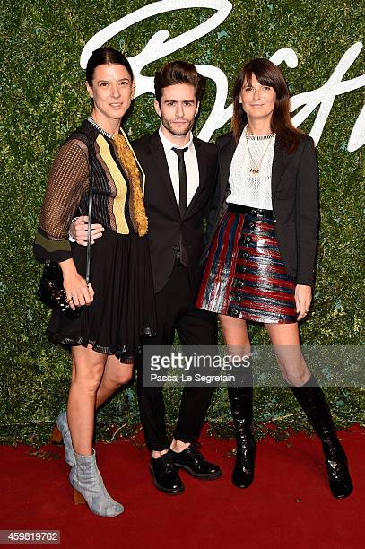 Camille Miceli Pelayo Diaz and MarieAmelie Sauve attend the British Fashion Awards at London Coliseum on December 1 2014 in London England
