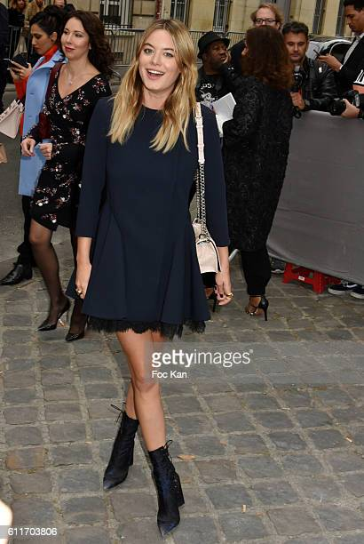 Camille Rowe attends the Christian Dior show as part of the Paris Fashion Week Womenswear Spring/Summer 2017on September 30 2016 in Paris France