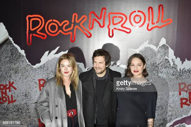 Camille Rowe Marion Cotillard and Guillaume Canet attend the 'Rock'N Roll' Premiere at Cinema Pathe Beaugrenelle on February 13 2017 in Paris France