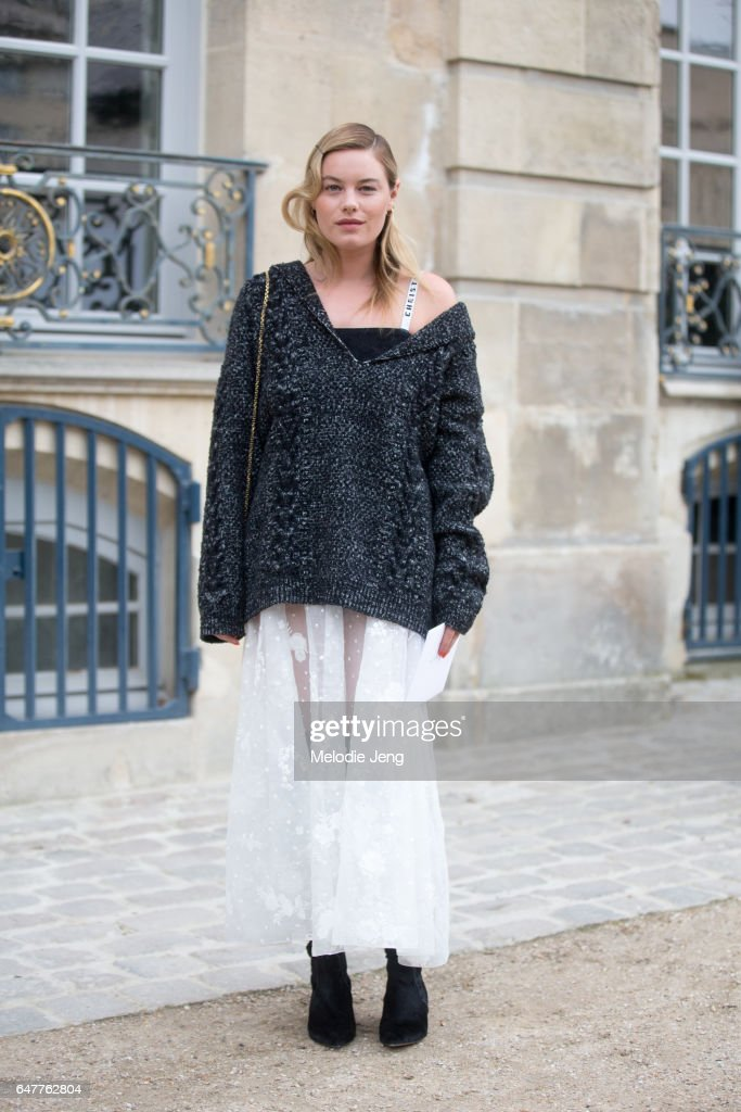 Camille Rowe outside the Dior show on March 3, 2017 in Paris, France.