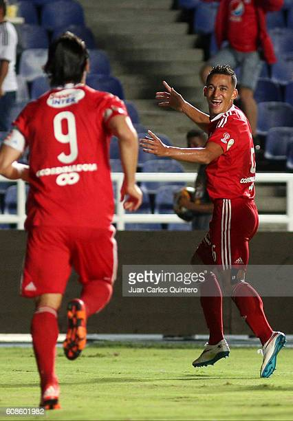 Camilo Ayala of America de Cali celebrates with teammate Ernesto Farias after scoring the opening goal during a match between America de Cali and...