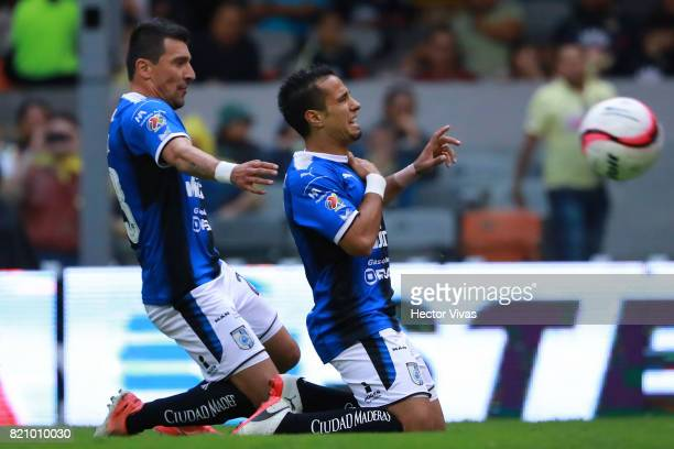 Camilo Da Silva of Queretaro celebrates with teammate Edgar Benitez after scoring the opening goal of his team during the 1st round match between...