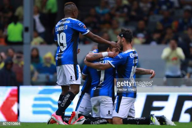 Camilo Da Silva of Queretaro celebrates with teammates after scoring the opening goal of his team during the 1st round match between America and...