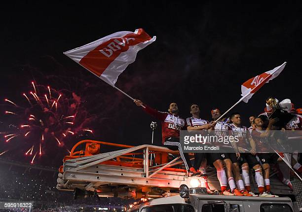 Camilo Mayada Ivan Alonso and Rodrigo Mora of River Plate celebrate after a second leg match between River Plate and Independiente Santa Fe as part...