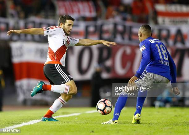 Camilo Mayada of River Plate and Eduar Preciado of Emelec compete for the ball during a group stage match between River Plate and Emelec as part of...