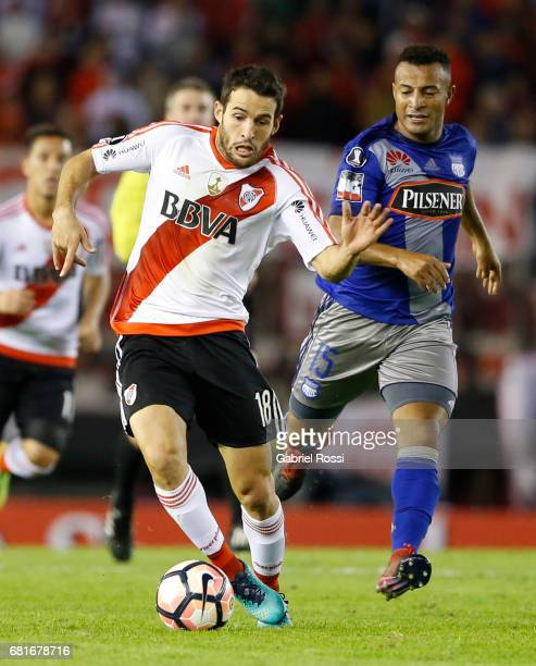 Camilo Mayada of River Plate and Pedro Quinonez of Emelec compete for the ball during a group stage match between River Plate and Emelec as part of...