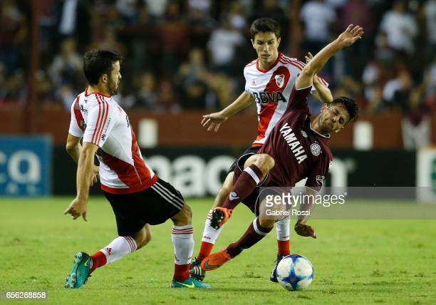 Camilo Mayada of River Plate fights for the ball with Lautaro Acosta of Lanus during a match between Lanus and River Plate as part of Torneo Primera...