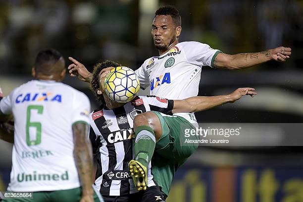 Camilo of Botafogo battles for the ball with Willian Thiego of Chapecoense during the match between Botafogo and Chapecoense as part of Brasileirao...