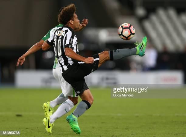 Camilo of Botafogo struggles for the ball with Diego Arias Hincapie of Atletico Nacional during a match between Botafogo and Atletico Nacional as...