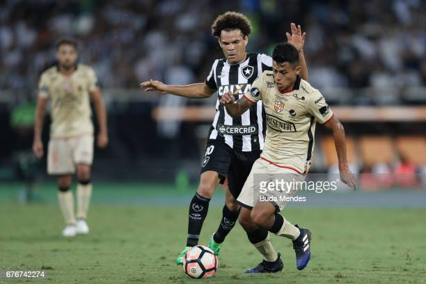 Camilo of Botafogo struggles for the ball with Richard Calderon of Barcelona de Guayaquil during a match between Botafogo and Barcelona de Guayaquil...