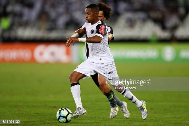 Camilo of Botafogo struggles for the ball with Robinho of Atletico MG during a match between Botafogo and Atletico MG as part of Brasileirao Series A...