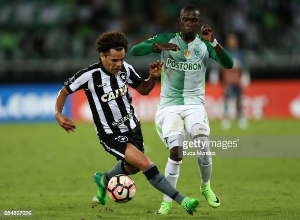 Camilo of Botafogo struggles for the ball with Rodin Quinones of Atletico Nacional during a match between Botafogo and Atletico Nacional as part of...