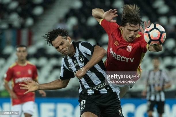 Camilo of Brazil's Botafogo vies for the ball with Sebastian Dubarbier of Argentina's Estudiantes de La Plata during their Copa Libertadores football...