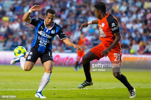 Camilo Sanvezzo of Queretaro and Oscar Murillo of Pachuca fight for the ball during the 11th round match between Queretaro and Pachuca as part of the...