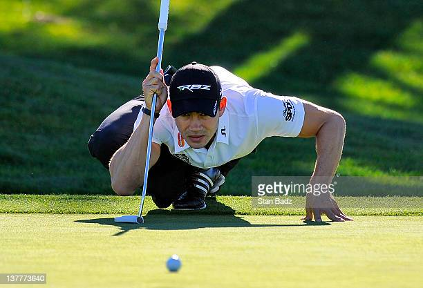 Camilo Villegas of Colombia checks his putt on the 12th hole on the North Course during the first round of the Farmers Insurance Open at Torrey Pines...