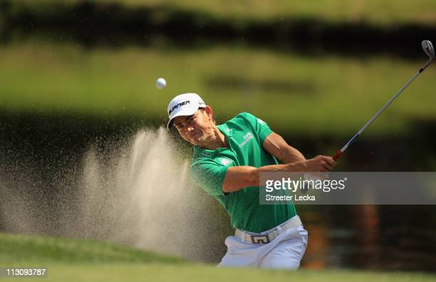 Camilo Villegas of Colombia hits a shot from the sand on the 8th hole during the third round of The Heritage at Harbour Town Golf Links on April 23...