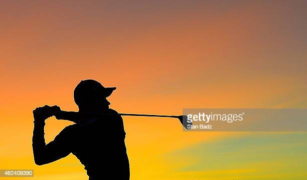 Camilo Villegas of Colombia hits a tee shot at sunrise during practice for the Waste Management Phoenix Open at TPC Scottsdale on January 28 2015 in...