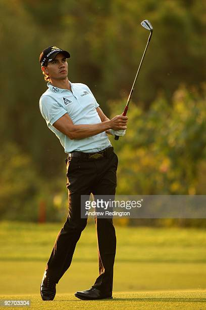 Camilo Villegas of Colombia hits his third shot on the eighth hole during the proam prior to the start of the WGCHSBC Champions at Sheshan...