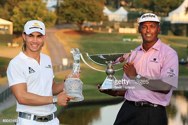 Camilo Villegas of Colombia holds THE TOUR Championship trophy while Vijay Singh of Fiji smiles with the FedExCup trophy after the final round of THE...